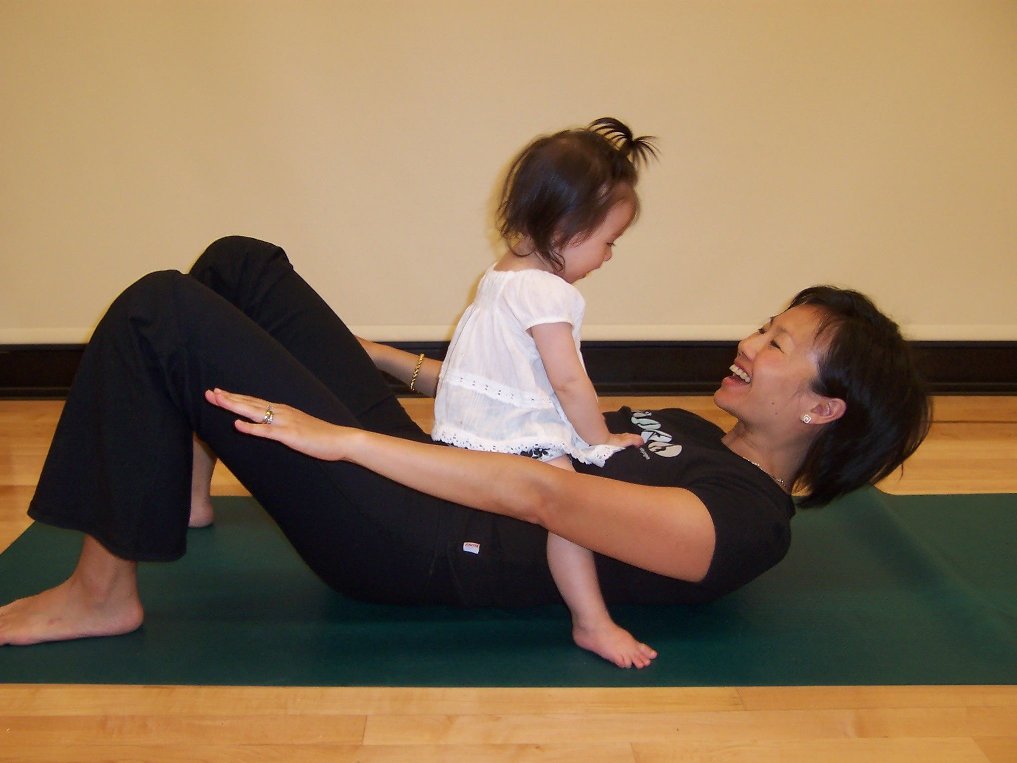 Woman doing yoga with toddler
