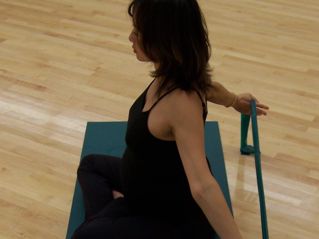 Woman stretching with elastic band