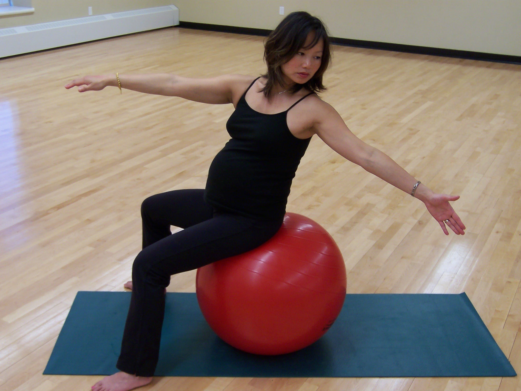 Woman doing excercises with balance ball